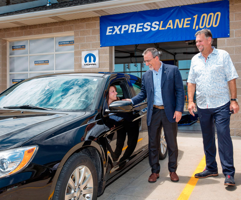 Pietro Gorlier, Head of Parts and Service (Mopar), FCA – Global (center), and store owner Dave Taylor welcome first customer Debbie Emling at the grand opening of the 1,000th operational Mopar Express Lane store, located in Bradley, Illinois. The new facility also represents the first official offsite stand-alone Express Lane store.